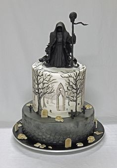 Double-barrel Coffee-Kahlua mud cake and bottom tier - Choc Cherry Mud Cake, filled with choc ganache. Airbrushed bottom tier and had painted eerie scenes, with a gum paste (Grim Reaper-style) figurine. A spooky, but fun cake to do :)