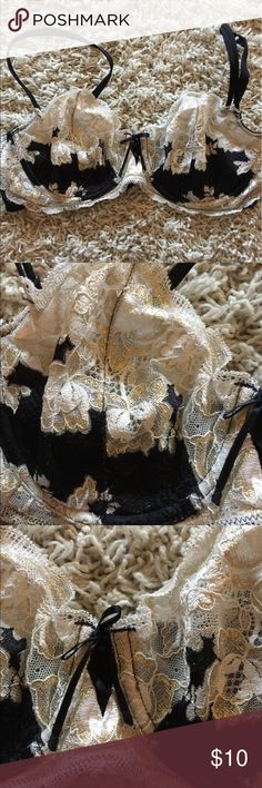Victoria's Secret Ver SexyUnlined Demi Bra This bra is super sexy. Sheer black & Creme lace embellished  with gold highlights. Cute little string tie in front. Great for Date night! Very lightly worn (non-smoker) Size 36C Victoria's Secret Intimates & Sleepwear Bras