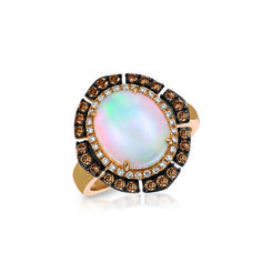 Le Vian Chocolatier® ring in 14K Strawberry Gold® featuring a 2.750 oval cut Neopolitan Opal™, the 2017 Gem of the Year, accented with .590 carat of Chocolate Diamonds® and Vanilla Diamonds®. For information contact Le Vian Customer Service customerservice@levian.com.
