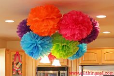 Thanks to a very crafty friend, her Pom design at her daughters 1st bday has inpired me to do the same (in hot pink, aqua & yellow poms) above the smash cake/cupcake table in dining room.     All Things G: Kate's 1st Birthday Party!