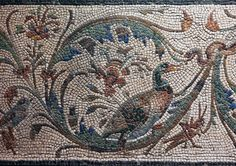 "Detail of a Roman floor mosaic depicting a border of an inhabited acanthus spiral (rinceau) including two birds and an insect -- perhaps a grasshopper -- originally part of a bath. The motif of the ""inhabited"" floral spiral is popular in the later republic. For examples in relief sculpture compare with details from the Ara Pacis (13-9 BCE). The mosaic is dated second to early first century BCE (according to the Capitoline Museums); Ant. Com. Inv. 32359 From the Via S. Lorenzo in Panispern..."