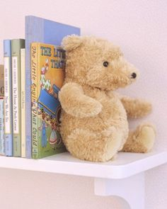 When Teddy's no longer needed in beddy, open his bottom with a seam ripper, empty his insides and refill with stones. Sew him back up and he becomes a bookend! #kidsrooms #playrooms #diy