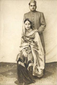 The cap, the crisp sherwani, the silk - very elegant. bollywood indian inspiration black and white image