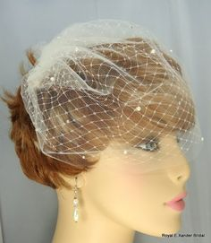 Laila is a beautiful 'Classic' double Russian Style Bridal Birdcage Blusher Veil. The wedding veil is made from illusion netting with an under lay of Russian netting with a soft cut edge for that trul