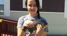 OKLAHOMA GIRL CATCHES TOOTHY SOUTH AMERICAN PIRANHA RELATIVE