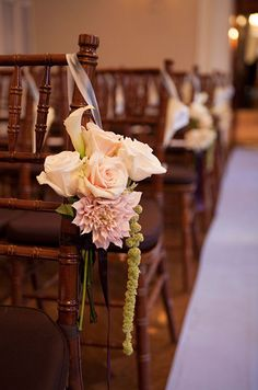A romantic  pink indoor wedding aisle bouquet
