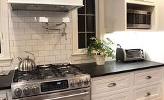 I think this might be it--basic look but style will hold up well--3 x 6 white subway tile with slightly grey grout, maybe not as dark as this, black pearl counters.  Maybe do marble subways to make it a bit prettier?