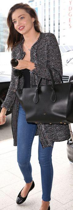 Miranda Kerr: Coat and shoes – Chanel Sunglasses – Prada Purse – Celine Necklace – Swarovski