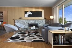Canterbury by CCI Renovations with Flos Glo-Ball Modern Lounge, Mid-century Modern, Canterbury House, Wood Wall Design, Beautiful Houses Interior, Elegant Living Room, Coffee Table Design, Center Table, Leather Furniture