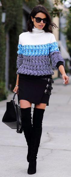 Turtleneck sweater, leather buckle detail crepe skirt, high boots, bag.