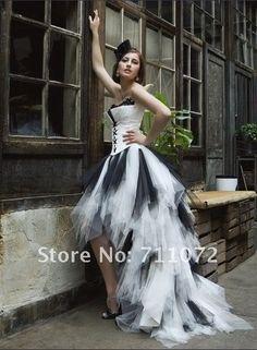 Love this mullet wedding dress