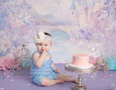 Baby posing in Cinderella themed Baby Cake Smash Photo by Brandie Narola Photography