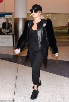 Flying high: Khloe Kardashian made a bold and slightly odd fashion statement as she flew out of Los Angeles, California, late Friday night