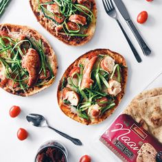 Pizza sur pain naan au homard, tomates, asperges et fromage cheddar | Metro