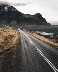 Keep on driving. In Iceland, it seems, it's all about the constant transition and transformation of everything you see. As soon as you get used to one landscape, it changes to the exact opposite. From flat black sand beaches to insanely high mountains to moss green hills and roads of snow. @icelandair #mystopover