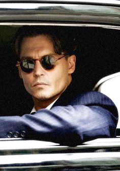 Johnny Depp as John Dillinger in Michael Mann's Public Enemies (2009)