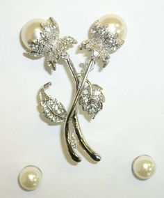 Pearl Pin and Pearl Earrings Set Goldfinger Jewelry. $7.95. 2 Pearl Buds Pin & Pierced Earring Set. Save 60%!