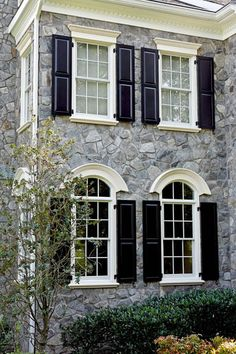 Stone exterior with black shutters