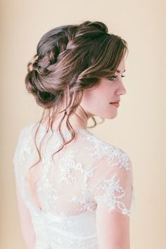 This is so beautiful and romantic and would definitely work if Carly decides to go for a high neck dress. I'm biased in favour of braids, so she may need to put an end to this theme soon if she isn't!