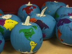 Teaching geography? Make Pumpkin Globes! - Tape down the continents and paint the pumpkin blue. The next day, remove the continents and color them in green with marker. Put two rubber bands around the pumpkin to represent the equator.