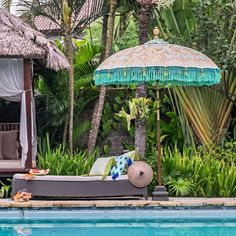 Our verdantly vivacious Tracy parasol. This gorgeous garden umbrella is Hand-made in Bali. Tracy is green, gold and blue with an intricately carved wooden pole. Perfect for summer shade with style.