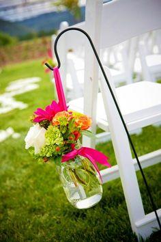 Flower jars suspended on hooks or hanging on hay bales