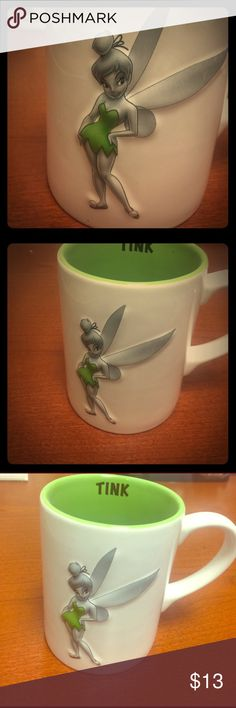 NWOT-Large Tinkerbell Coffee Mug NWOT-Large Tinkerbell Coffee Mug from Disney!! Never used. Decoration only. Absolutely love this mug! 😍😍🦋🦄🍄🌈🏰 Poor TINK has been collecting dust on my desk! She needs some love! Excellent condition & super clean/white! No chips, stains or cracks! Absolutely perfect in every way! 😀😀 Bundle & Save!! ❤❤🥀 Jerry Leigh/Disney Other