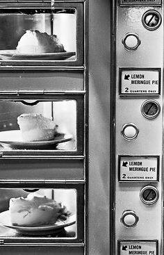 """The Automat Machine, 1912 """"The average man, an Australian observer wrote, became a """"manipulator of destiny"""" in the Automat, suddenly finding himself """"before Ali Baba's cave. He whispers 'Open sesame!' and lo! a ham sandwich or a peach dumpling is his for the taking, also for a nickel."""""""""""