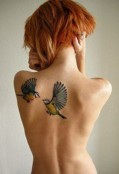 Love birds tattoos on upper back for woman - spring tattoos