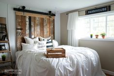 A cheater reclaimed wood barn door headboard with faux hardware. Get the look without the expense or difficulty using reclaimed wood and junk for hardware!