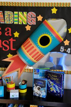 The Gilded Pear: Reading Is A Blast Bulletin Board & Free Printable Rocket Bulletin Boards, Space Bulletin Boards, Welcome Bulletin Boards, Reading Bulletin Boards, Classroom Bulletin Boards, School Decorations, School Themes, Library Decorations, Space Theme Classroom