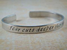 Game of Thrones Jewelry / Game of Thrones Bracelet / Handstamped Jewelry / Aluminum Handstamped Cuff Bracelet / Fear Cuts Deeper Than Swords on Etsy, $14.00