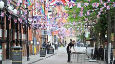 Preparations are made for a Jubilee street party on Canal Street in Manchester, England Friday, June 1, 2012. (AP / Martin Rickett / PA Wire)