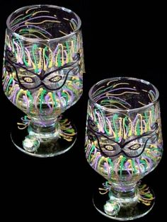 Mardi Gras Mask High Ball Glasses-10.5oz. - This colorful set of (2) high ball glasses are traditionally painted in green, purple and gold. Let the merriment begin with your fun-loving friends any time of year, no need to wait for Mardi Gras.