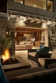 Indoor/Outdoor style & decor. Like that the wall opens up to the outdoors