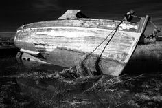 Monochrome conversion from an infrared image. Old boat hull on Heswall Marsh.