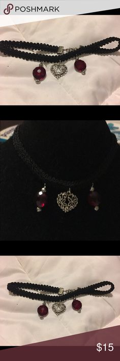 Lacy choker Pretty lacy handcrafted choker! This choker features a gorgeous filigree pewter toned heart and to deep red crystals. It measures approximately 12 inches with a 3 inch extender Jewelry Necklaces