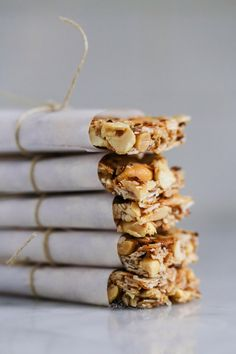 Make these all the time with mixed nuts! They are a hit! feasting at home: Coconut Almond Bars