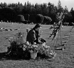 Tess Gallagher at Raymond Carver's grave. Port Angles, USA  http://wesleyeverstmemorial.tumblr.com/page/12