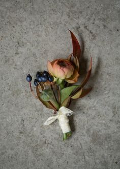 Rust colored boutonnière with berries. Groom Style.