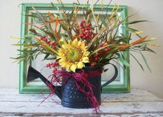 Cute Sunflower arrangement in vintage watering can. Sunflower Arrangements, Fall Arrangements, The Lord Is Good, I Love America, Autumn Inspiration, Silk Flowers, Halloween Decorations, Centerpieces, Arts And Crafts