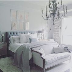 Gray and white master bedroom with chandelier
