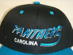 """NEW Carolina Panthers NFL Two Tone Vintage Snapback Flatbill Cap / Hat by Reebok. $15.97. Made by NFL Team Apparel, 100 % Cotton, Adjustable Plastic Strap. Vintage Carolina Panthers Flat Bill Snap Back Cap / Hat Fits sizes 6 7/8 to 7 3/8. **Officially Licensed Product of the NFL**. """"Carolina Panthers"""" very nicely embroidered on front panel of hat. Panther logo embroidered on the back of hat. """"Carolina Panthers"""" very nicely embroidered on front panel of hat. Panthers logo embroid..."""