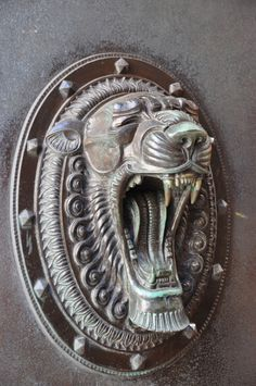 Panther's head door ornament.  From a set of bronze doors from a20th century inter-war buildingat 7 Water Street;Liverpool. Part of which formed the head office for the Bank of Liverpool.