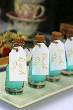 """Drink Me"" Bottles from an Alice In Wonderland Dessert Table via Kara's Party Ideas 