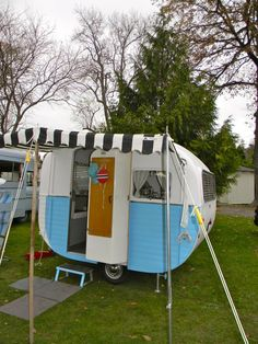 A cute black and white awning goes perfectly with this 8 foot Starlette out of New Zealand.  Vintage Caravan Magazine