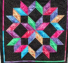 i have made a few of these carpenter stars & love it....this is different with these colors :)