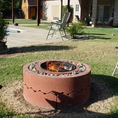 Tree rings and a grill bottom and you got an inexpensive firepit!