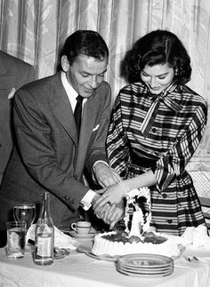 Frank Sinatra and Ava Gardner cut into their second wedding cake after arriving in Havana for their honeymoon, 1951