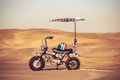 Intended to get you down to the beach for early morning waves, the Goof Bike by Deus Ex Machina even offers storage for your surf board. Deus Ex Machina, Volkswagen, Ultimate Garage, Bike Builder, Ape Hangers, Engin, New Honda, Surf Outfit, Mini Bike